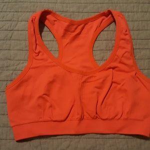 Women's Tek Gear orange, sports bra, size small